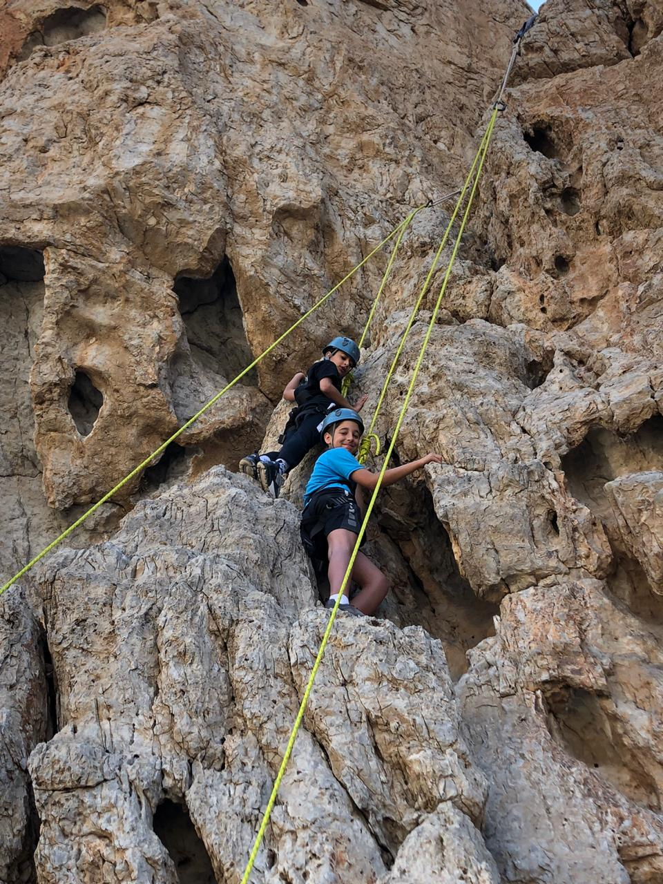 Grade 5 students rock climbing in Ras Al Khaimah.