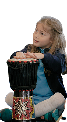 One of our elementary student strumming a drum during her music class.